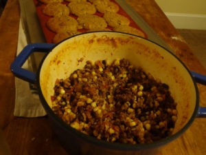 Vegan Chili with Zucchini Muffins looming in the background