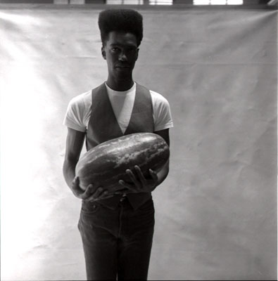 """Black Man Holding Watermelon"" from Carrie Mae Weems' ""Ain't Jokin"" series"